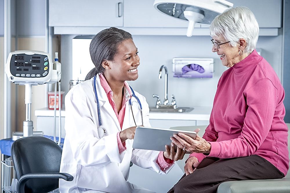 Happy hospital nurse with happy patient